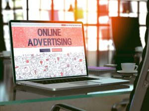Online Advertising Concept. Closeup Landing Page on Laptop Screen in Doodle Design Style. On Background of Comfortable Working Place in Modern Office. Blurred Toned Image. 3D Render. - Four Networking Event Ideas That Will Get Everyone Talking